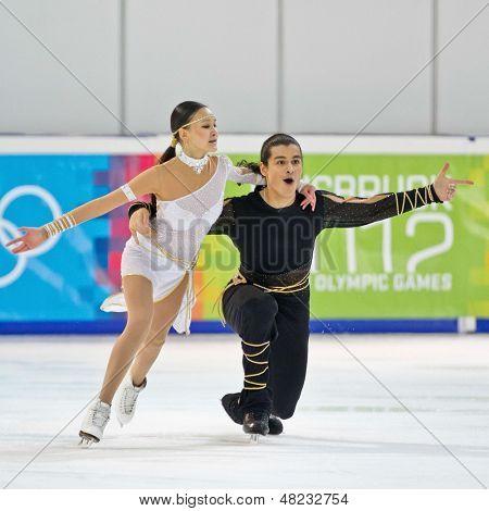 INNSBRUCK, Österreich - Januar 17 Karina Uyurova und Ilias Ali (Kasachstan) Platz 6 im Eis Paare