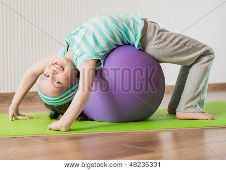 smiling  girl with the fitness ball   at home