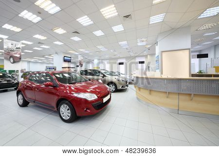 MOSCOW - AUGUST 28: Cars stand near racks for customers in dealership Avtomir on Baykalskaya, on August 28, 2012 in Moscow, Russia. Avtomir Group - large car dealer in Russia.
