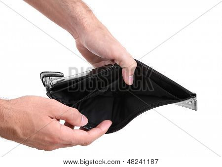 Man showing his empty purse, isolated on white