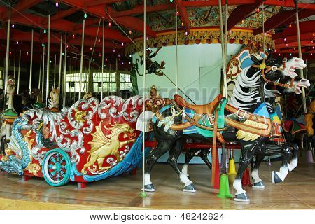 Horses on a traditional fairground Central Park carousel
