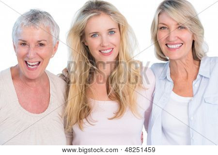 Three generations of  cheerful women smiling at camera on white background