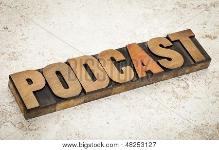 podcast - internet broadcasting concept -word  in vintage letterpress wood type on a ceramic tile background