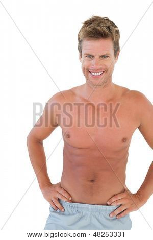Shirtless man with hands on hips on white background