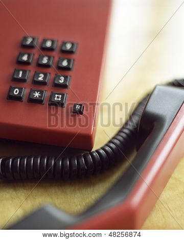 Extreme closeup of a phone off the hook