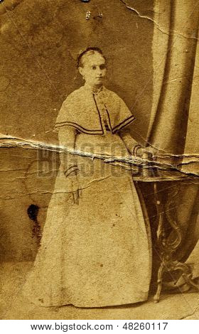 MOSCOW, RUSSIA, CIRCA 1899: Antique photo, portrait of a woman in a long Dress, circa 1899