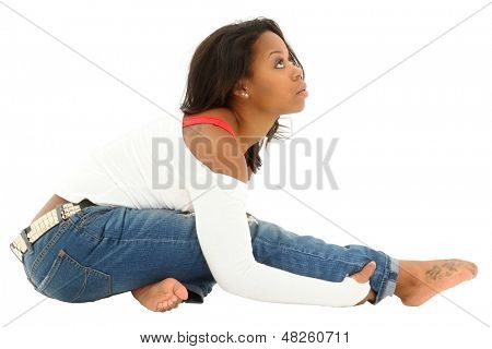 Beautiful athletic black woman stretching before hip hop dance. Clipping path.
