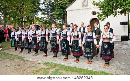 SIROGOJNO, SERBI - JULY 12: Dancers of Folklore ensembles on festival Petrovdan's days on July 12, 2013. in Sirogojno, Zlatibor, Serbia.