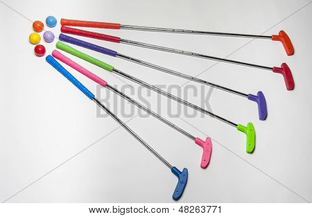 Brightly Colored Mini Golf Clubs And Balls
