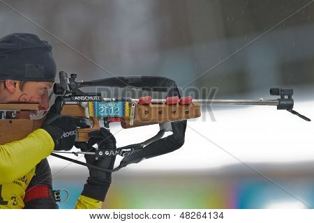 SEEFELD, AUSTRIA - JANUARY 19 Maximilian Janke of team Germany wins the mixed biathlon relay event on January 19, 2012 in Seefeld, Austria.