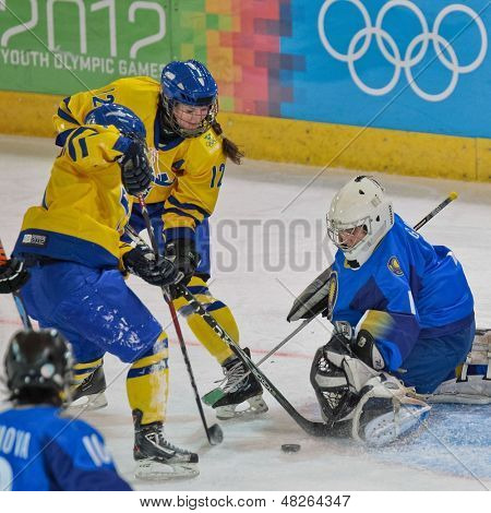 INNSBRUCK, AUSTRIA - JANUARY 20 Sabina Kueller (Sweden) tries to score a goal as her team beats Kazachstan 11:0 in the ladies' ice hockey tournament on January 20, 2012 in Innsbruck, Austria.