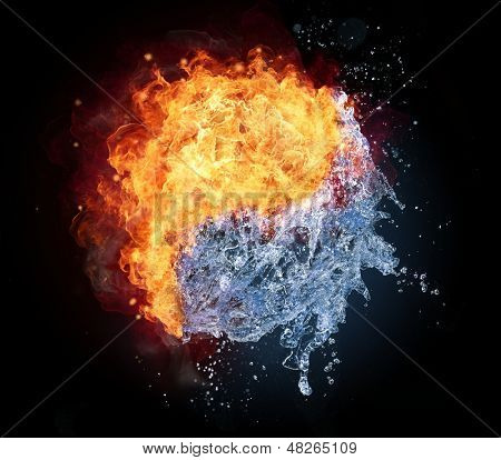 Yin Yang symbol made of water and fire, isolated on black background