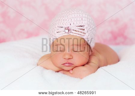 Newborn Baby Girl in a Pink Flapper Hat