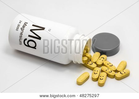 Tipped over bottle of Magnesium vitamins