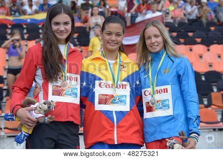 DONETSK, UKRAINE - JULY 14: Medalists in pole vault during 8th IAAF World Youth Championships in Donetsk, Ukraine on July 14, 2013. From left Obizajeva, Latvia, Peinado, Venezuela, Lutkovskaya, Russia