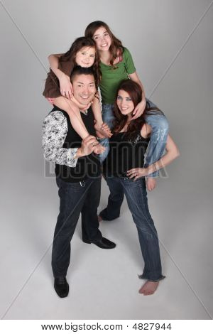 Fun And Unusual Vertical Family Portrait