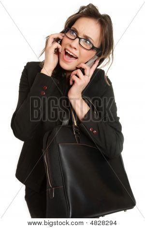 Businesswoman Talking By Two Cellphones