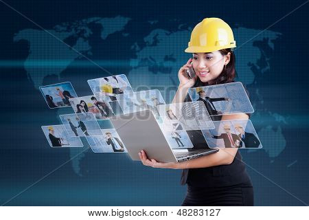 Beautiful Contractor Calling And Using Internet On Blue