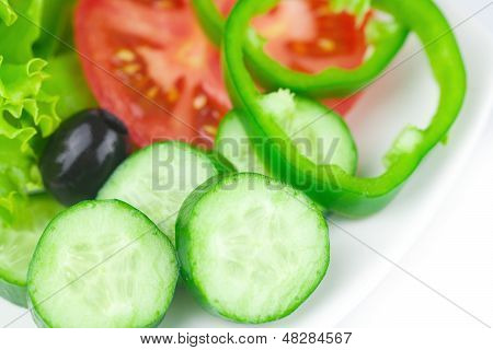 Black Olive,lettuce, Tomato, Cucumber And Pepper In A Bowl