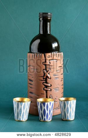 Bottle And Wine-glasses