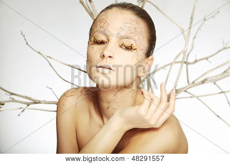 beautiful young woman with stylezed facepaint