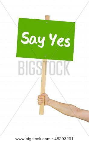 Person holding a sign saying Say yes