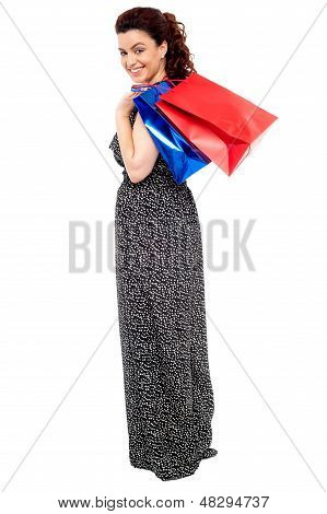 Full Length Portrait Of Shopaholic Woman