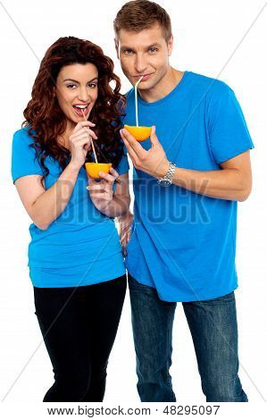 Young Couple Drinking Orange Juice Together