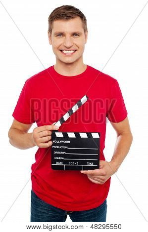 Smiling Young Guy Holding Clapperboard