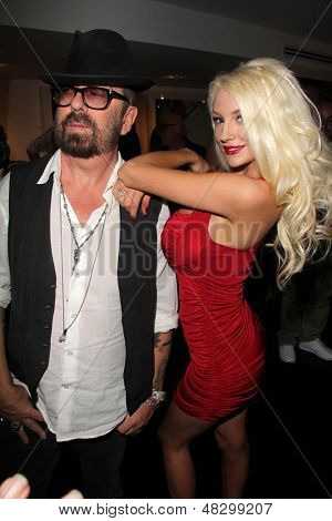 LOS ANGELES - JUL 12:  Dave Stewart, Courtney Stodden at the Dave Stewart: Jumpin' Jack Flash & The Suicide Blonde Photo Exhibit at the Morrison Hotel Gallery on July 12, 2013 in West Hollywood, CA