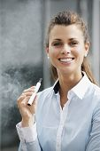 image of e-cigarettes  - portrait of young female smoker smoking e - JPG