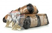 foto of smuggling  - Packages of  narcotics isolated on white - JPG