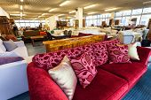 stock photo of thrift store  - A furniture store with colorful antique sofa - JPG