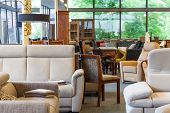 foto of thrift store  - A warehouse with furniture such as sofas chairs and lamps - JPG