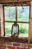 Oil Lamp On Old Broken Window