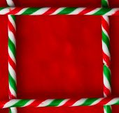 picture of candy cane border  - Candy cane border on red velvet background - JPG