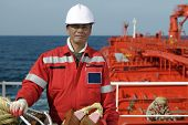 foto of lng  - Seamen on an old boatswain of the tanker ship - JPG