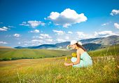 stock photo of serbia  - Beautiful young woman picking flowers on the slopes of Zlatibor mountain - JPG