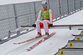 SEEFELD, AUSTRIA - JANUARY 19 Colton Kissel (USA) prepares to go down the ski jump in Seefeld during