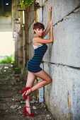 foto of prostitution  - beautiful brunette woman sexy girl standing on a city street - JPG
