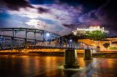 stock photo of mozart  - Night view of Salzburg with castle in background and Mozart bridge over Salzach river in foreground - JPG