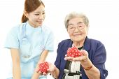 stock photo of polite girl  - Friendly nurse cares for an elderly woman isolated on white background - JPG