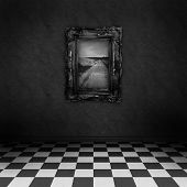 Empty, dark, psychedelic room with black and white checker on the floor and a painting