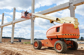 picture of mortar-joint  - builder worker putting cement mortar on concrete pole joint at construction site using lifting boom machinery - JPG