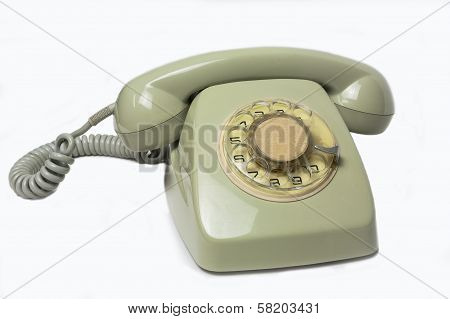 Vintage telephone receiver isolated on white background