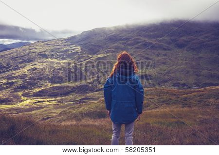 Woman Admiring View From Mountain Top