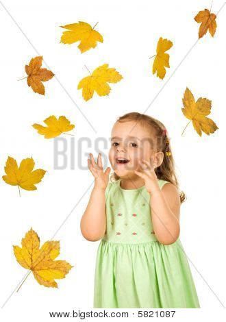 Happy Surprised Little Girl With Falling Autumn Leaves