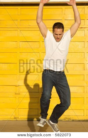 Man Jumping With Shadow