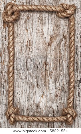 Rope Frame And Wood Background