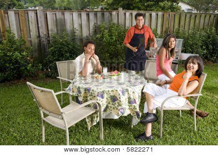 Family relaxing in backyard